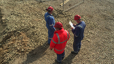 Site personnel checking plans